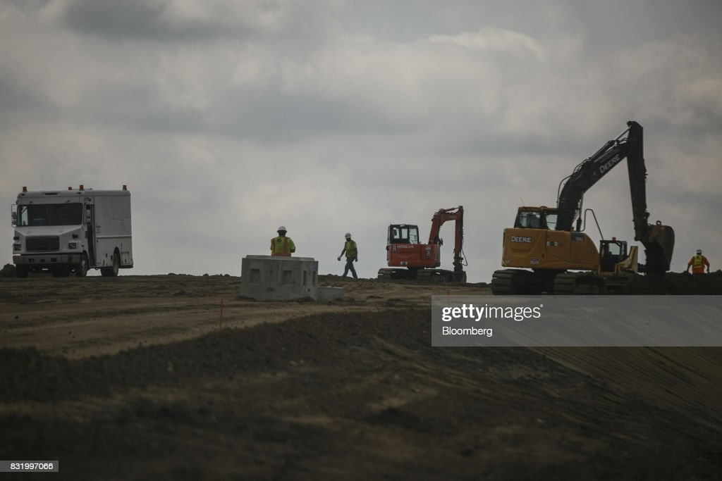 Contractors work on the construction site of the American Mobility Center (ACM) in Ypsilanti, Michigan, U.S., on Tuesday, Aug. 15, 2017. Representative Debbie Dingel, a Democrat from Michigan, and Representative Bob Latta, a Republican from Ohio, visited the ACM to meet with experts in the autonomous vehicles industry as the two work together to advance bipartisan self-driving vehicle legislation through the House floor. Photographer: Sean Proctor/Bloomberg via Getty Images