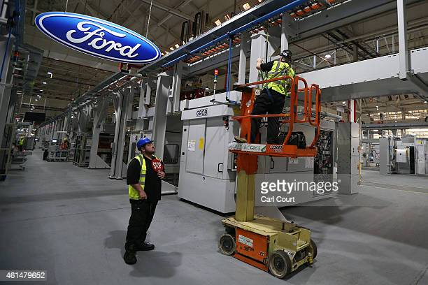 Contractors work on the yettobecompleted engine production line at a Ford factory on January 13 2015 in Dagenham England Originally opened in 1931...