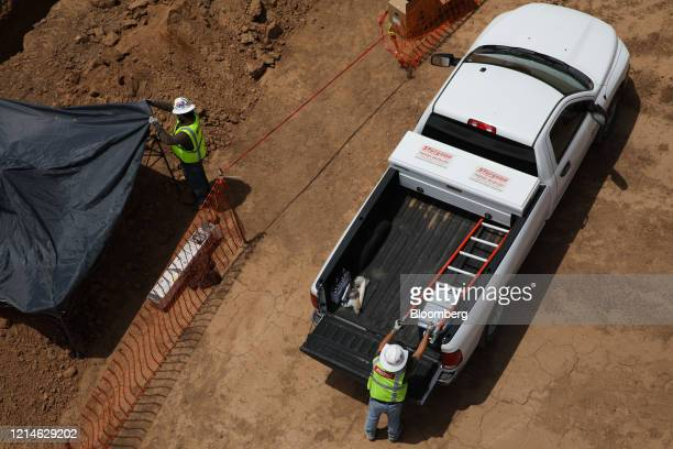 Contractors work outside the Lucid Motors Inc. Manufacturing facility while under construction in Casa Grande, Arizona, U.S., on Thursday, May 14,...