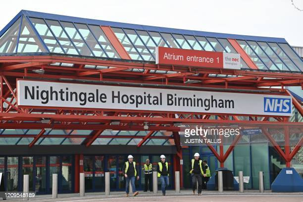 Contractors work to transform the Birmingham National Exhibition Centre into the Nightingale Hospital Birmingham in Birmingham central England on...
