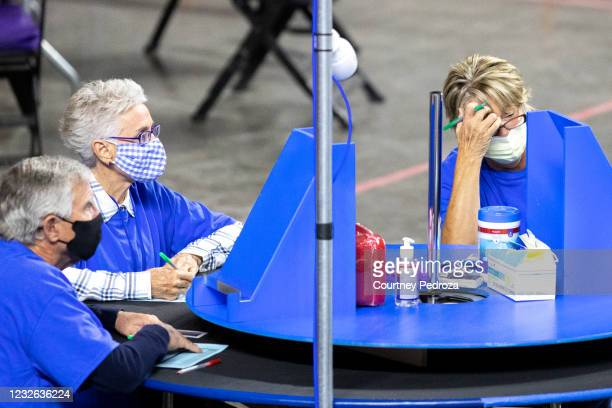 Contractors working for Cyber Ninjas, who was hired by the Arizona State Senate, examine and recount ballots from the 2020 general election at...