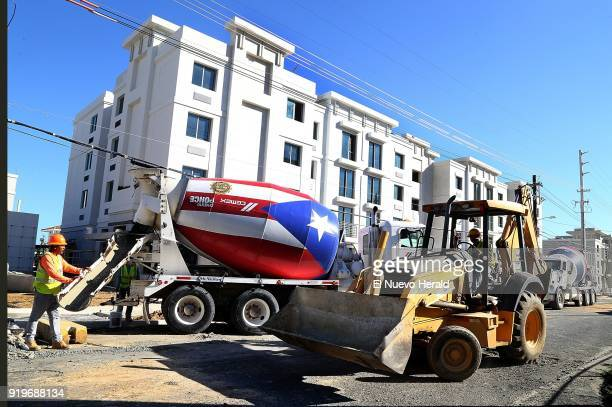 Contractors works on final details at 'Las Gladiolas' a government housing project in San Juan Puerto Rico on December 1 2017
