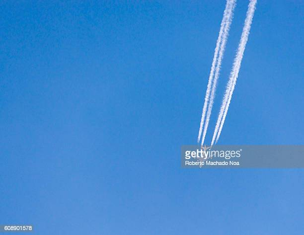 Contrails formed from engine exhaust of aeroplane against clear blue sky Contrails or vapor trails are lineshaped clouds sometimes produced by...