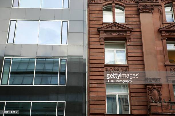 contrast between facades of an old, pre war residential building, and a new apartment complex in berlin (germany), district of mitte. - central berlin stock photos and pictures