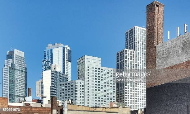 contrast between old buildings and new office towers in downtown brooklyn, new york city - brooklyn new york stock pictures, royalty-free photos & images