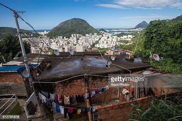 Contrast between poor house in Favela Santa Marta and middle-class buildings of Botafogo quarter in the south zone of Rio de Janeiro, Brazil -...