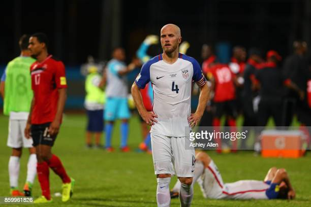 A contrast of emotions as captain Michael Bradley of the United States mens national team reacts as Trinidad and Tobago pull of a win during the FIFA...
