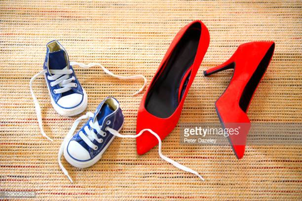 contrast of mother's and daughter's shoes - stiletto stock pictures, royalty-free photos & images