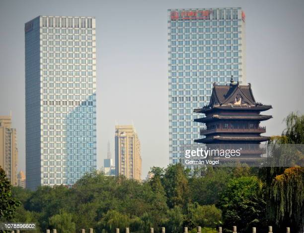 contrast of old and modern chinese towers in the hefei skyline - vogel stock pictures, royalty-free photos & images