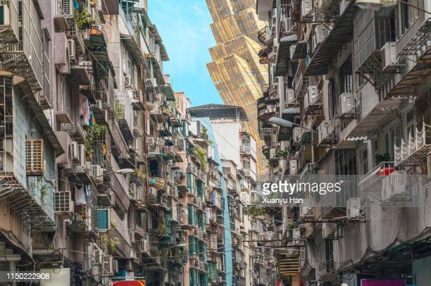 contrast of residential areas and modern buildings in macao - macao stock pictures, royalty-free photos & images