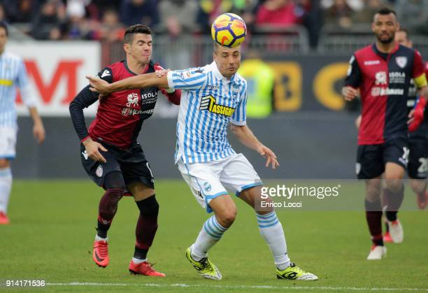 Contrast with Diego Farias of Cagliari and a player of Spal during the serie A match between Cagliari Calcio and Spal at Stadio Sant'Elia on February...