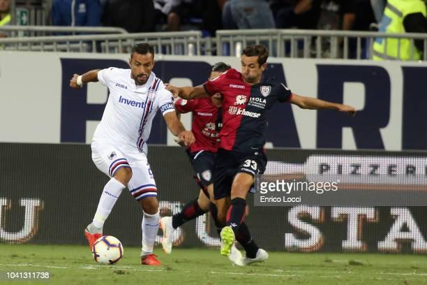 Contrast with Fabio Quagliarella and Darijo Srna during the serie A match between Cagliari and UC Sampdoria at Sardegna Arena on September 26 2018 in...