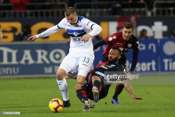 Contrast with Hans Hateboer of Atalanta and Joao Pedro of Cagliari during the Serie A match between Cagliari and Atalanta BC at Sardegna Arena on...