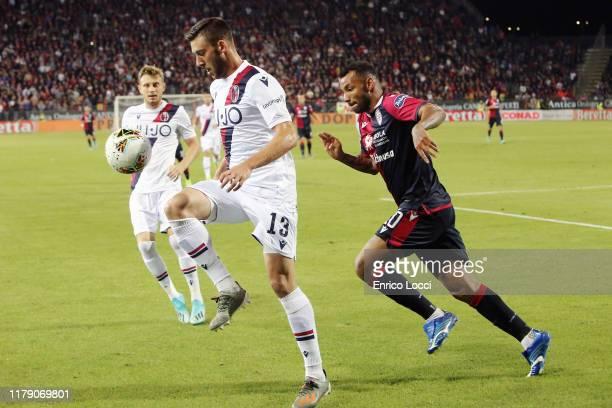 contrast with Joao Pedro of Cagliari and Mattia Bani of Bolognaduring the Serie A match between Cagliari Calcio and Bologna FC at Sardegna Arena on...