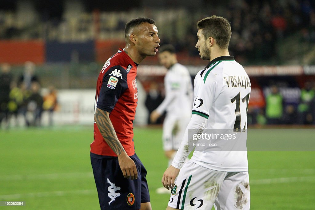 Contrast with Joao Pedro of Cagliari and Sime Vrsaljko of Sassuolo during the Serie A match between Cagliari Calcio and US Sassuolo Calcio at Stadio Sant'Elia on January 24, 2015 in Cagliari, Italy.