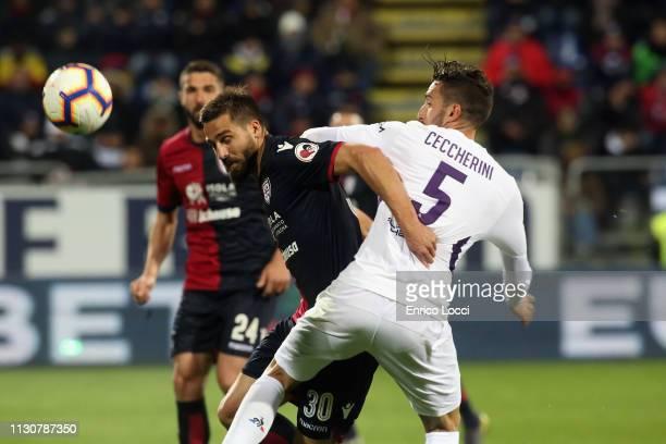 contrast with Leonardo Pavoletti of Cagliari and Federico Ceccherini of Fiorentina during the Serie A match between Cagliari and ACF Fiorentina at...