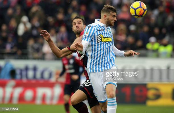 contrast with Leonardo Pavoletti of Cagliari and Francesco Vicari of Spal during the serie A match between Cagliari Calcio and Spal at Stadio...