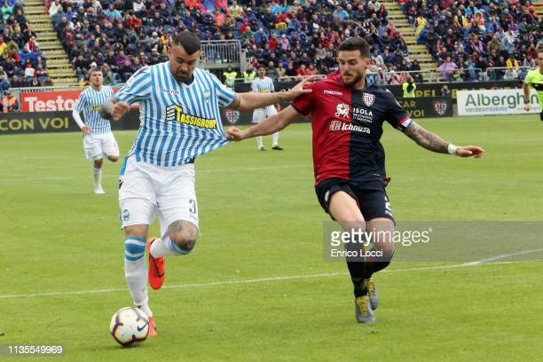contrast with Luca Ceppitelli of Cagliari and Andrea Petagna of Spal during the Serie A match between Cagliari and SPAL at Sardegna Arena on April 7...