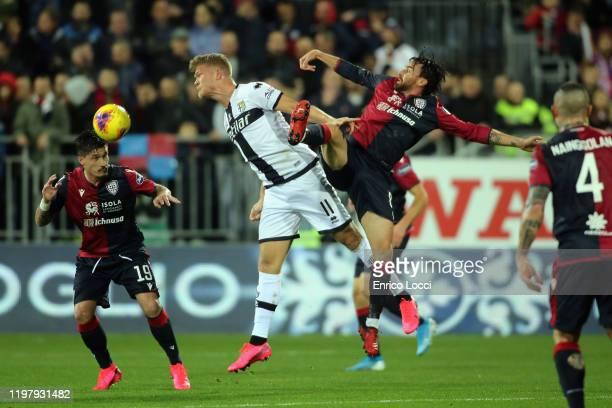 contrast with Luca Cigarini of Cagliari and Andreas Cornelius of Parma during the Serie A match between Cagliari Calcio and Parma Calcio at Sardegna...