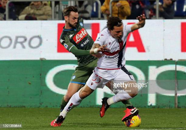 Contrast with Luca Pellegrini of Cagliari and a player of Napoli during the Serie A match between Cagliari Calcio and SSC Napoli at Sardegna Arena on...