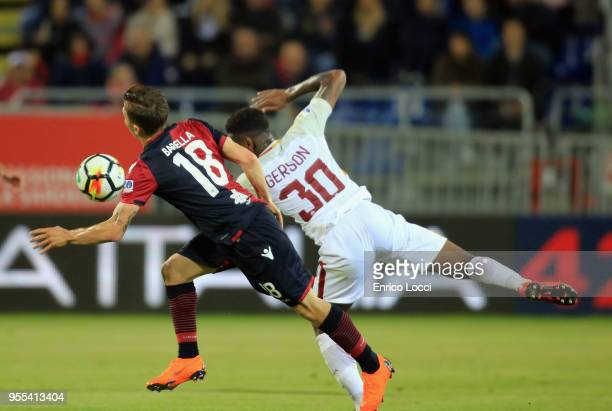 Contrast with Nicolò Barella of Cagliari and Gerson of Romaduring the serie A match between Cagliari Calcio and AS Roma at Stadio Sant'Elia on May 6...