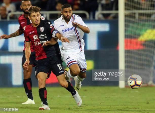 Contrast with Nicolò Barella of Cagliari and Gregoire Defrel of Sampdoria during the serie A match between Cagliari and UC Sampdoria at Sardegna...