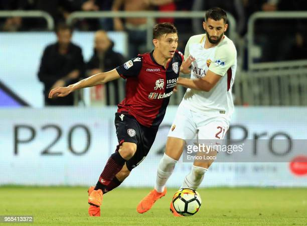 contrast with Nicolò Barella of Cagliari and Maxime Gonalons of roma during the serie A match between Cagliari Calcio and AS Roma at Stadio Sant'Elia...