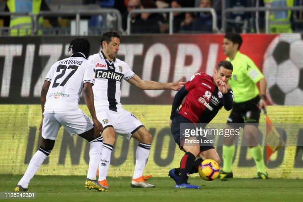 contrast with Simone Padoin of Cagliari and Massimo Gobbi of Parma during the Serie A match between Cagliari and Parma Calcio at Sardegna Arena on...