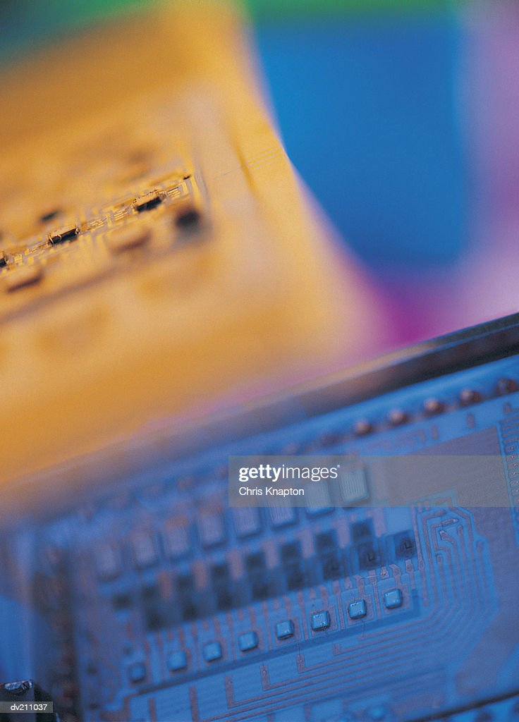 Contrasting cyan and yellow circuit board parts : Stock Photo