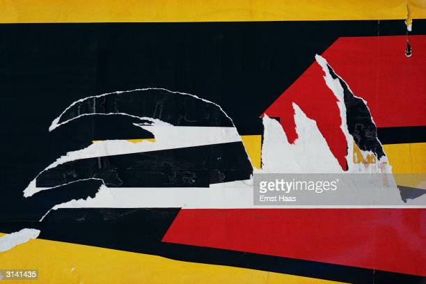 Contrasting lines of red yellow and black on a torn poster in New York City Colour Photography book