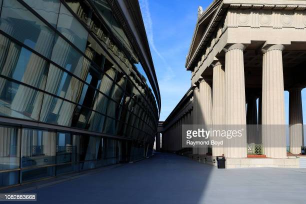 Contrasting the new modern Soldier Field with the old Neoclassical Doric columns at the East entrance to Soldier Field home of the Chicago Bears...
