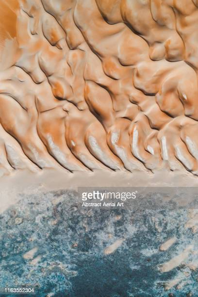 contrasts at the edge of the desert taken from above, united arab emirates - elements stock photos and pictures
