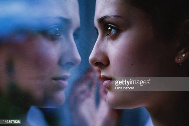 contrasts - girl in mirror stock photos and pictures