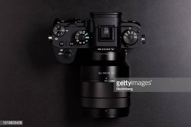 Control dials and buttons sit on a Sony Corp Alpha a9 mirrorless digital camera mounted with an FE 2470mm f/4 ZA OSS standard zoom lens manufactured...