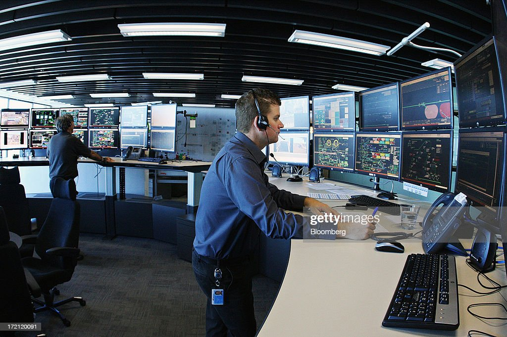 Control officers monitor the flow of iron ore from pit-to-port at BHP Billiton Ltd.'s new Integrated Remote Operations Center in Perth, Australia, on Tuesday, July 2, 2013. BHP Billiton is the world's largest mining company. Photographer: Sergio Dionisio/Bloomberg via Getty Images