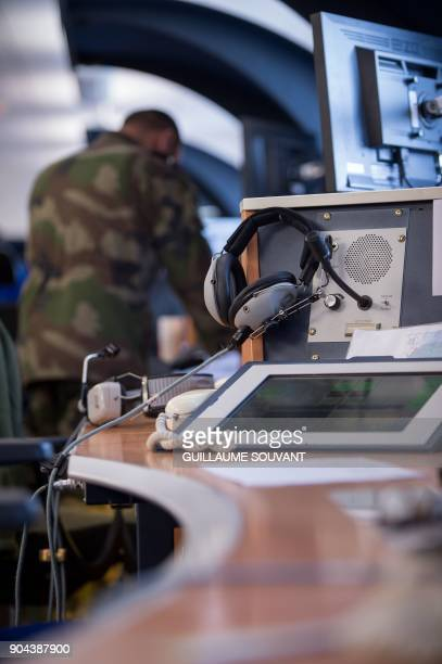 A control operator of France's French air defence radar systems works on radar screens in the control room of the Control and Detection Center CDC...