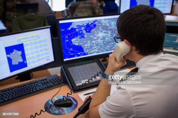 A control operator of France's French air defence radar systems works on radar screens in the control room of the French Air Force Control and...