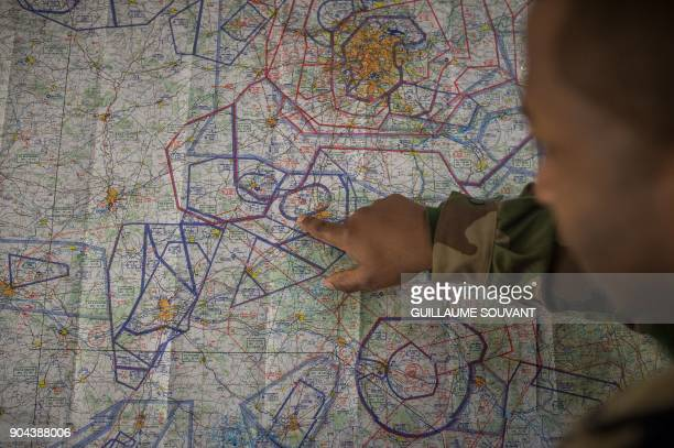 A control operator works on aerial maps in the BVIC the Centralised Flights Control Room of the French Air Force Control and Detection Center CDC...
