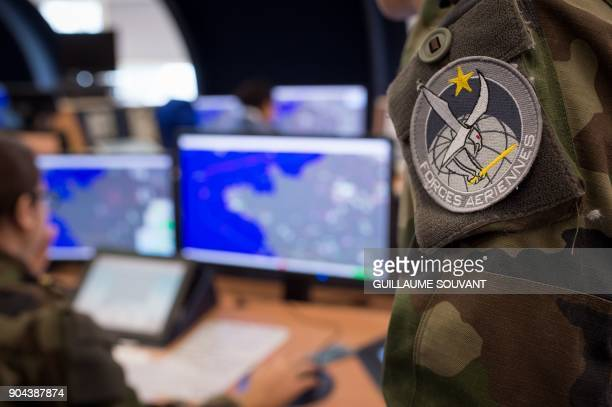 Control operators of France's French air defence radar systems work on radar screens in the control room of the French Air Force Control and...