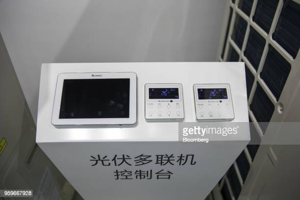 Control panels for Gree Electric Appliances Ltd air conditioner units sit on display the company's showroom in Zhuhai China on Wednesday March 28...