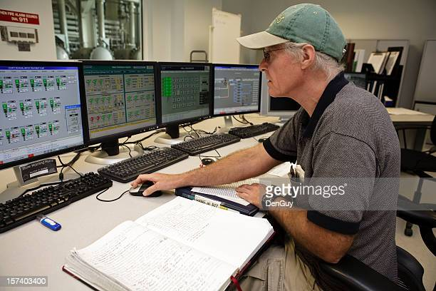 control room technician intensely working on computers - sewer stock pictures, royalty-free photos & images