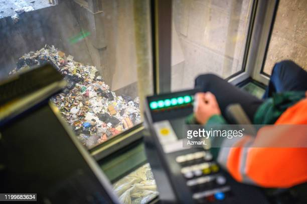 control room view of indoor recycling facility - waste management stock pictures, royalty-free photos & images