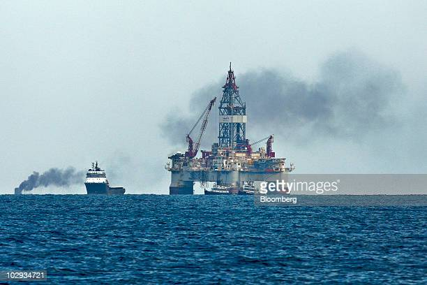 A controlled burn is seen in the distance behind the Seadrill West Sirius platform an ultradeepwater semisubmersible rig assigned by Devon Energy and...