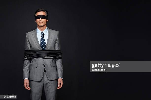 controlled by the business world - blindfold stock pictures, royalty-free photos & images