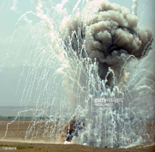 A controlled detonation of munitions prepared by 703rd EOD Company 2nd Platoon Team 6 is seen outside Camp Clark in Mandozai district Khost province...
