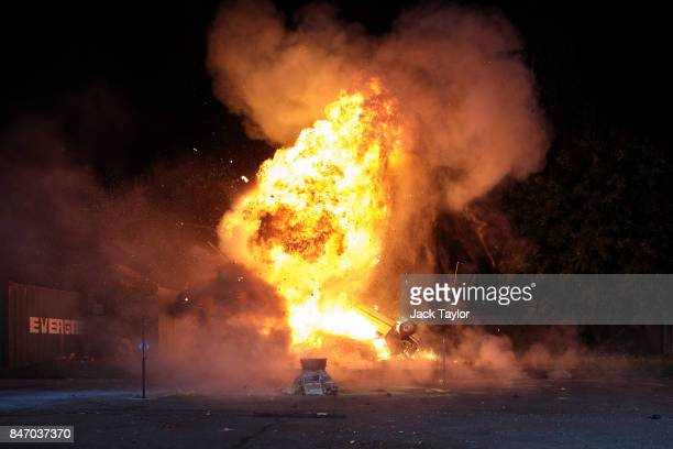 A controlled explosion of a car is carried out during an open evening at the Artem special effects workshop on September 14 2017 in Greenford England...