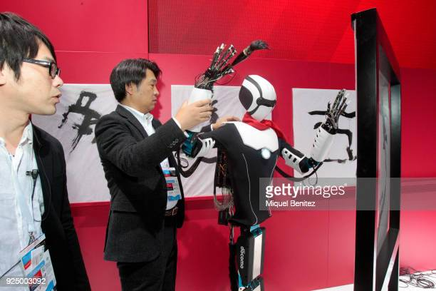 A 5G controlled humanoid robot on display on the NTT DOCOMO stand during the Mobile World Congress the world's biggest mobile fair on February 27...