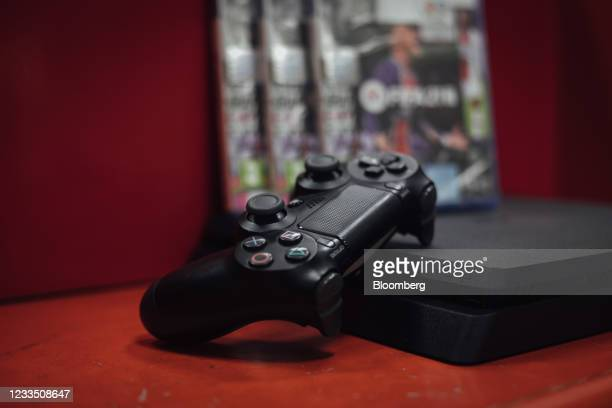 Controller and a PlayStation 4 console in a video games store in Paris, France, on Thursday, June 17, 2021. The reinstatement of Cyberpunk 2077 to...