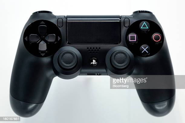 A controller for Sony Computer Entertainment Inc's PlayStation 4 video game console is displayed at a news conference in Tokyo Japan on Monday Sept 9...