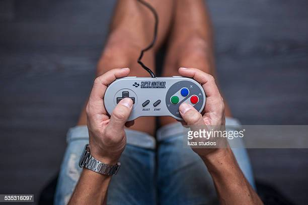 snes controller - super nintendo game controller - nintendo stock pictures, royalty-free photos & images